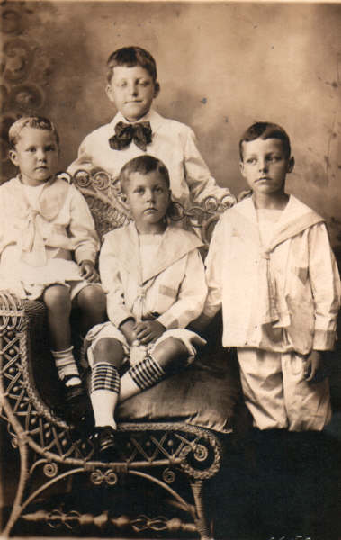 Early boys in brown tinted photo from late 19th century